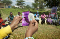 Image of woman opening an FC2 Female Condom sachet during a field training