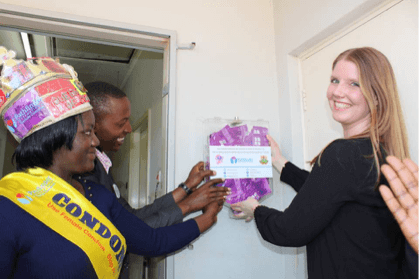 President of FHC, Denise van Dijk was granted the honor to put up the FC2 female condom dispensers on campus