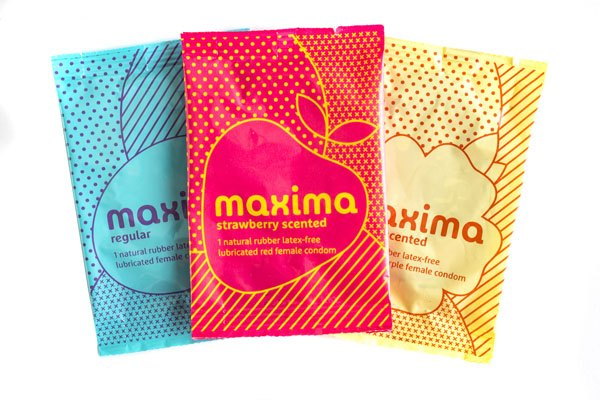 Maxima Female Condom, group product shot, strawberry, vanilla, regular, in individual packages