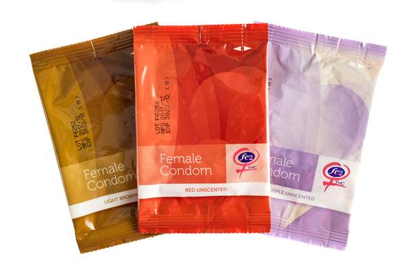 FC2 Female Condom, group product shot, purple, red, light brown, in individual packages