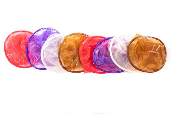 FC2 Female Condom, group product shot, purple, red, clear, light brown